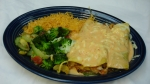 Enchiladas los Cabos - Three seafood enchiladas topped with our new chipotle cheese sauce. Served with rice and vegetables.